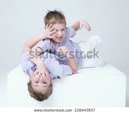 two brother struggling isolated on white - stock photo