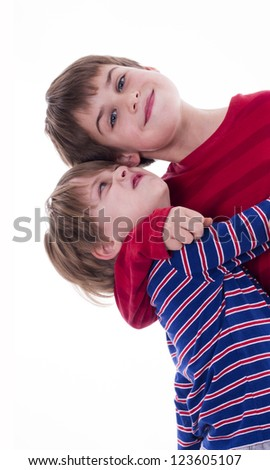 two brothers hugging - stock photo