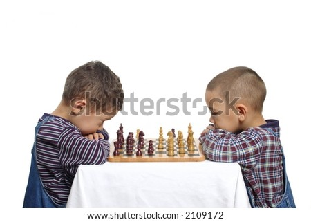 Two brothers playing chess - stock photo