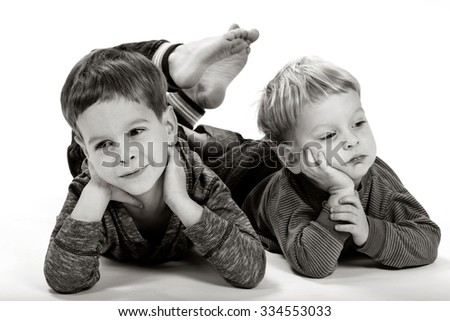 Two brothers posing in studio - stock photo