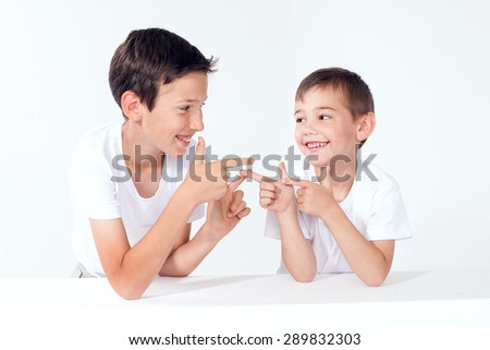 Two brothers posing, smiling. Family portrait. - stock photo