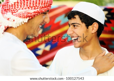 Two brothers, two arabic young people - stock photo