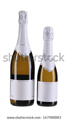 Two brown bottles of champagne. Different sides. Small and big - stock photo