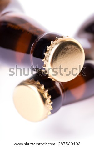 Two brown bottles of ice cold beer isolated on white - stock photo