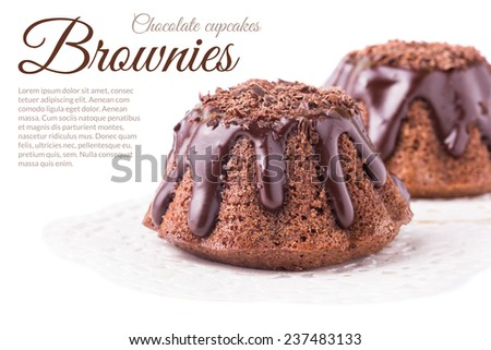 Two brownies served on napkin isolated on white - stock photo