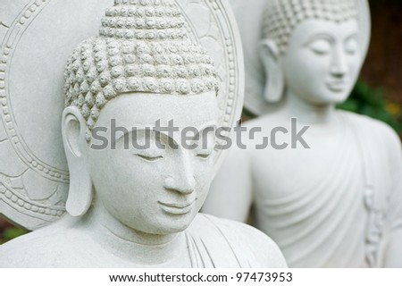 Two buddha statue - stock photo
