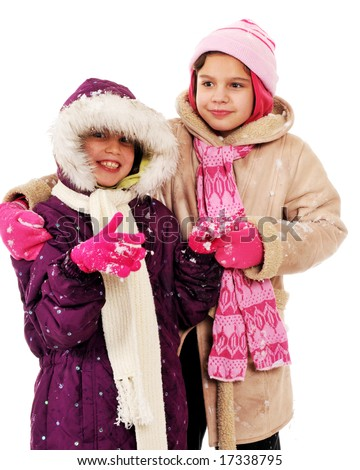Two bundled girl-buddies who've been playing in the snow. - stock photo