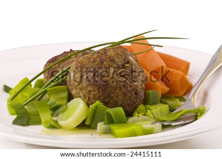 Two burger with vegetable on plate isolated on white - stock photo