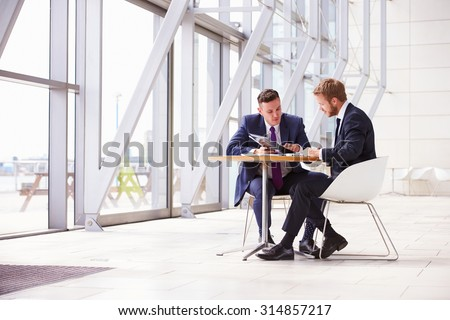 Two business colleagues at meeting in modern office interior - stock photo