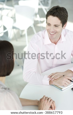 Two business colleagues, having a discussion in an office - stock photo