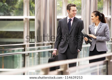 Two Business Colleagues Having Discussion Whilst Walking Outside Office - stock photo
