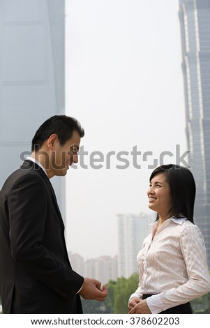 Two business colleagues near skyscrapers - stock photo