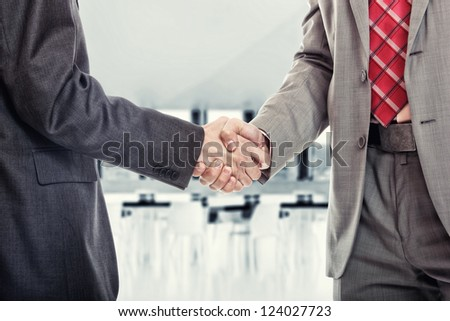 Two business man handshake at the office building - stock photo
