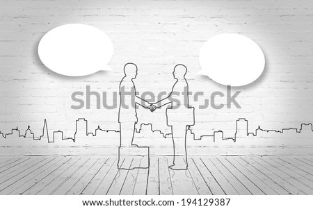 Two business man shake hand silhouettes city - stock photo