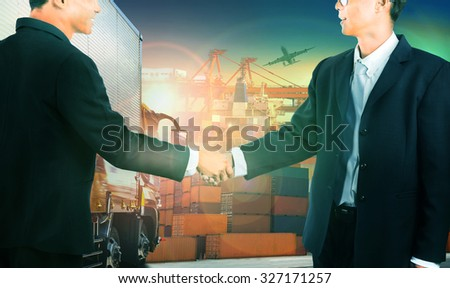 two business man shaking hand against container truck in shipping port ,container dock and freight cargo plane flying above use for transportation and logistic industry - stock photo