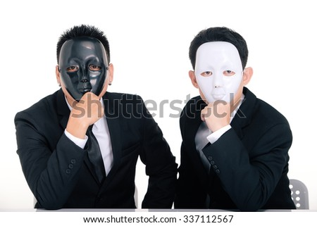 Two business man white masks and black masks isolated on white - stock photo