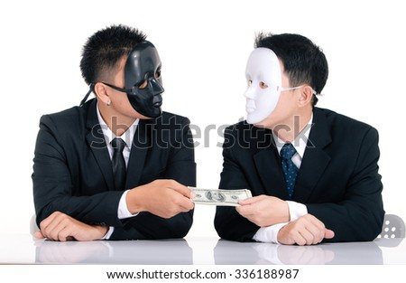 Two business man white masks and black masks isolated on white,  giving a hundred dollars - stock photo