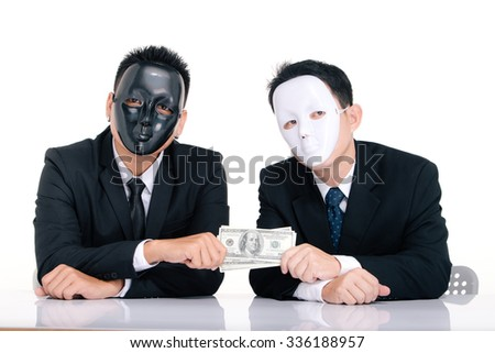 Two business man white masks and black masks isolated on white, giving a hundred dollars, graft - stock photo