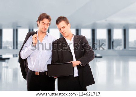 Two business men at the office - stock photo