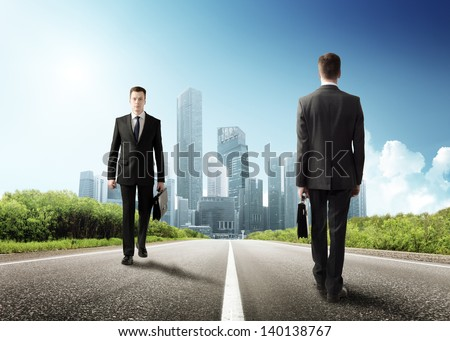 two business men on the road - stock photo