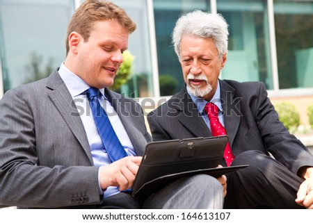 Two business men partner talking about project - stock photo