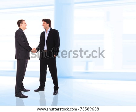 two business men shaking hands at corporate - stock photo