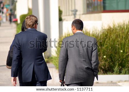 Two business men walking - stock photo