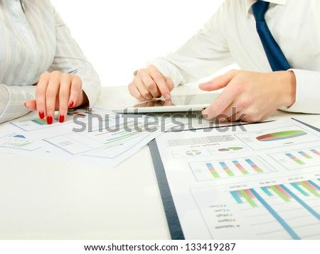 two business partners discussing documents lying - stock photo