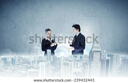 Two business people examining design of construction model - stock photo