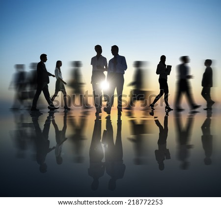 Two Business people in motion - stock photo