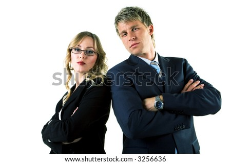 Two business people (male / female) looking rather arrogant - stock photo