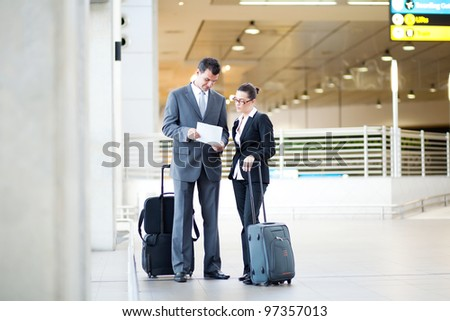 two business people meeting at airport - stock photo