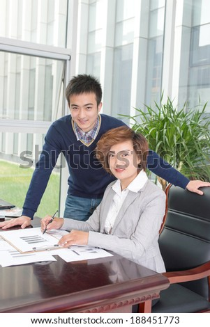 Two business people meeting, look at smile of the lens - stock photo