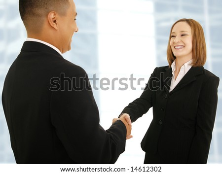 two business people shake hand. concept for business deal or business team - stock photo