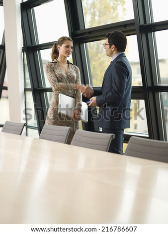 Two business people shake hands. - stock photo