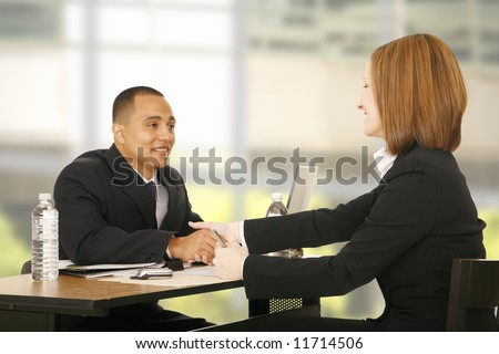 two business people shaking hand over table. focus on the woman. concept for business deal, team work, selling or agreement - stock photo