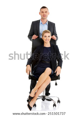 Two business people supporting each other - stock photo