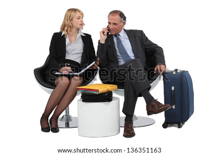 Two business people waiting - stock photo