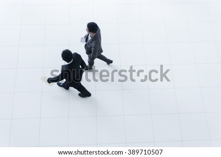 Two business people walking, high angle - stock photo