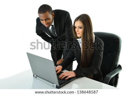 Two Business People Working on a Project - stock photo