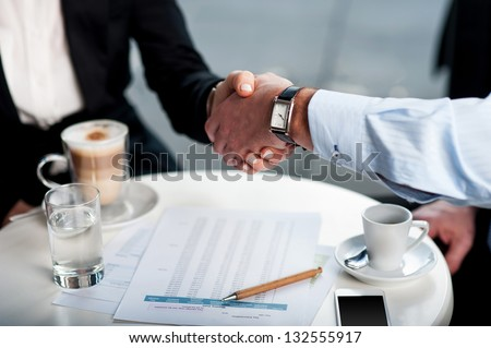 Two business tycoons meet over a coffee and closed long-term deal. - stock photo
