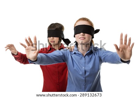 two business woman blind folded leading the other - stock photo