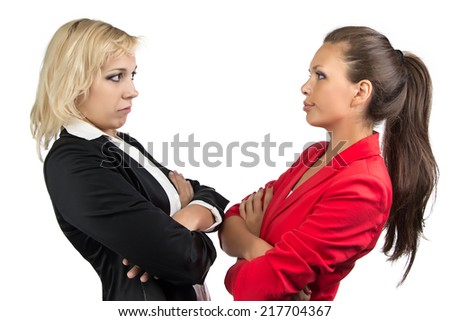 Two business woman looking at each other - stock photo