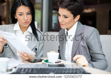 Two business women in meeting - stock photo