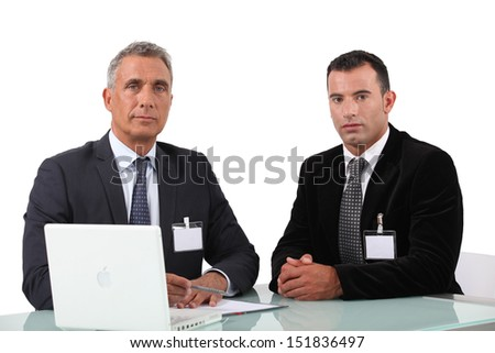 Two businessman at work. - stock photo