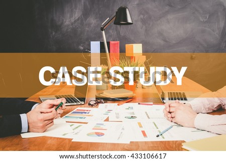 Two Businessman Case Study working in an office - stock photo