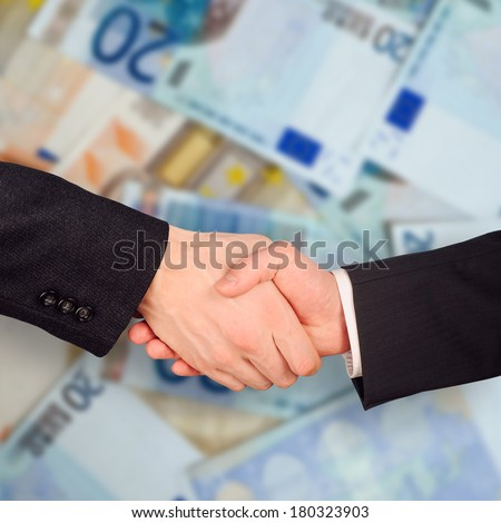 Two businessman hand grip on Euro notes background - stock photo