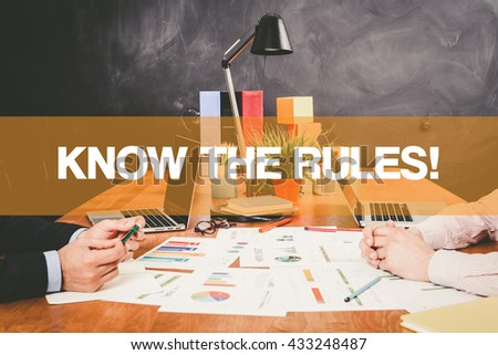 Two Businessman Know The Rules! working in an office - stock photo