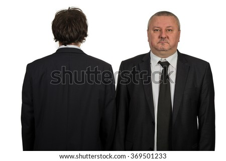 Two businessman looking at white background - stock photo