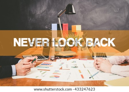 Two Businessman Never Look Back working in an office - stock photo